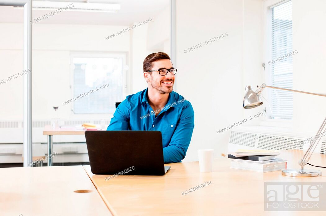 Stock Photo: Young man using laptop.