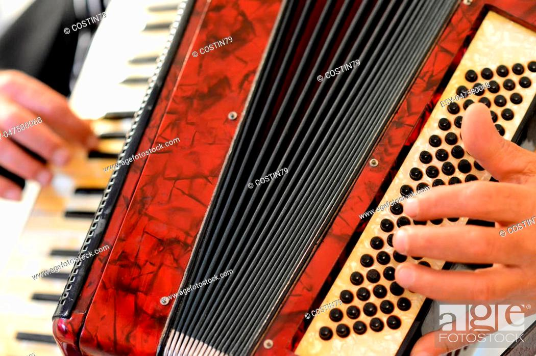 Stock Photo: Someone who plays the accordion.