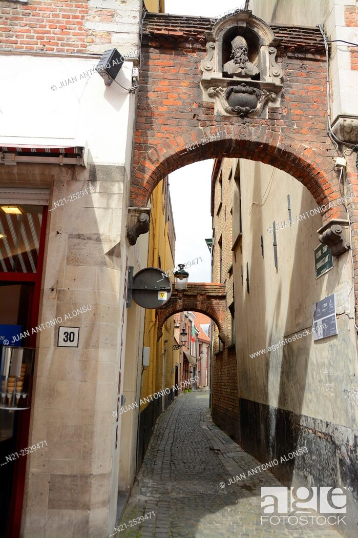 Stock Photo: A narrow alley in Bruges, Belgium, Europe.