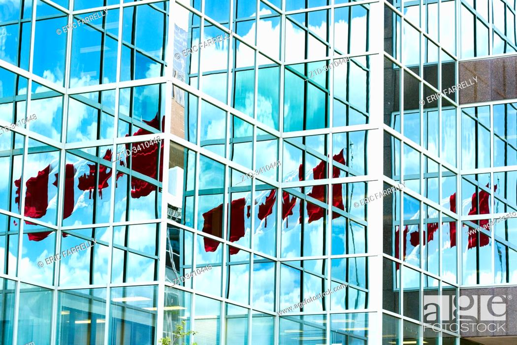 Stock Photo: Canadian flag reflected in offices windows at Halifax seafront. Nova scotia Canada.