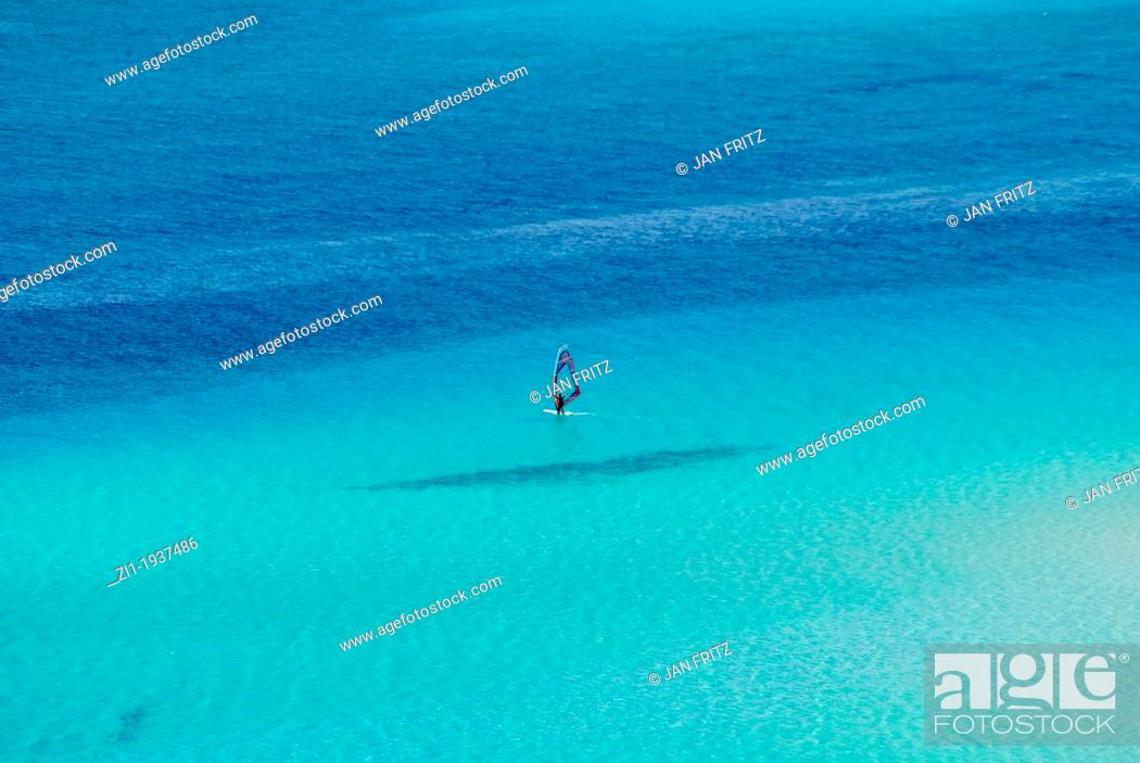 Imagen: blue sea with windsurfer at Spiaggia, Sardinia.