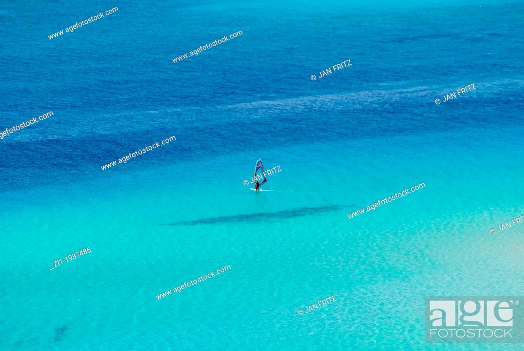 Photo de stock: blue sea with windsurfer at Spiaggia, Sardinia.