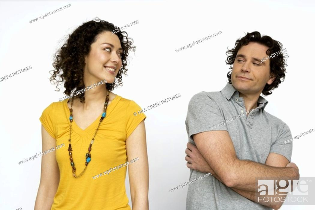 Stock Photo: Young couple looking at each other.