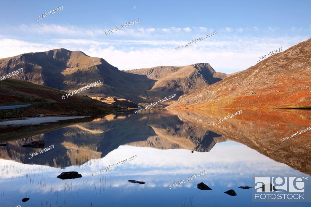 Stock Photo: Ogwen Valley Gwynedd North Wales UK Europe  November Still water of Llyn Ogwen lake reflecting Y Garn and Foel Goch mountains in Snowdonia National Park.