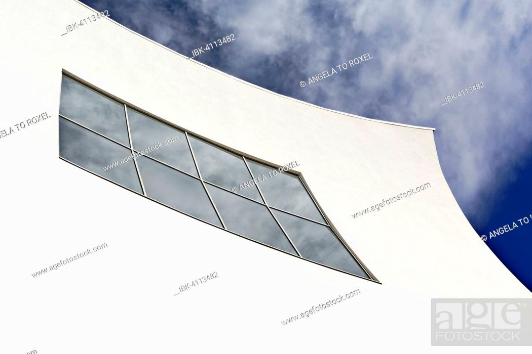 White concave facade, facade detail, clouds reflected in the