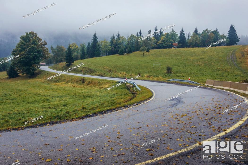 Stock Photo: Road on Puchaczowka mountain pass separating Krowiarki Mountains from Snieznik Mountains massif in Eastern Sudetes, Poland.