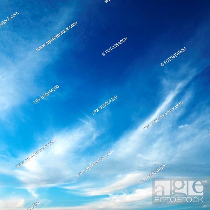 Stock Photo: Cirrus cloud formation in blue sky.