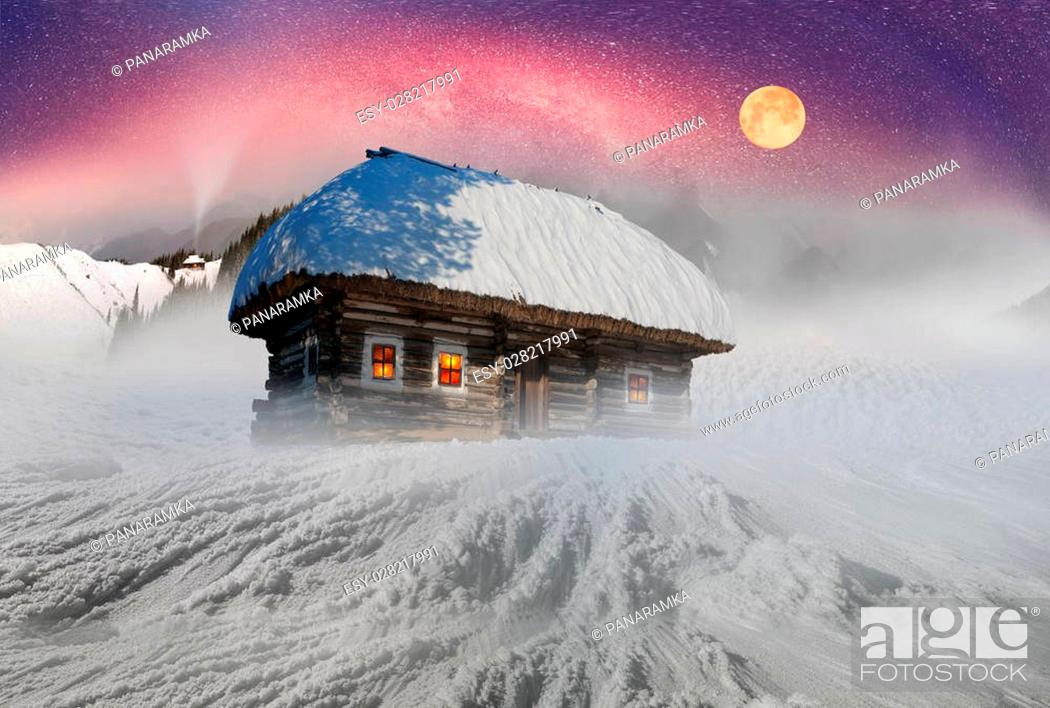 Stock Photo: In March, the sudden cold and blizzard covered mountains, houses a silver snow fencing, morning and evening these days were especially beautiful when the sun.