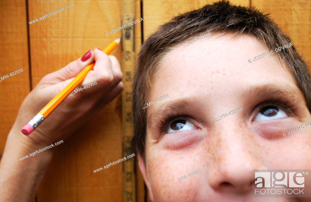 Stock Photo: Boy being measured for height.