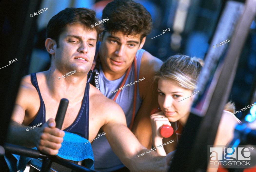 Stock Photo: Men and woman in a gym.