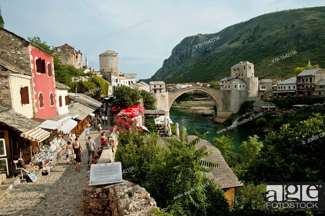 Stock Photo: Cobbled street and the Stari Most Peace Bridge on the Neretva river Mostar Bosnia- Herzegovina Balkans Europe.