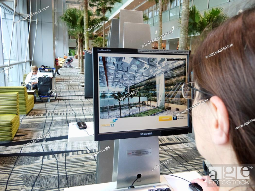 Stock Photo: Public free internet access computer screens at Terminal 3 in Changi Airport in Singapore.