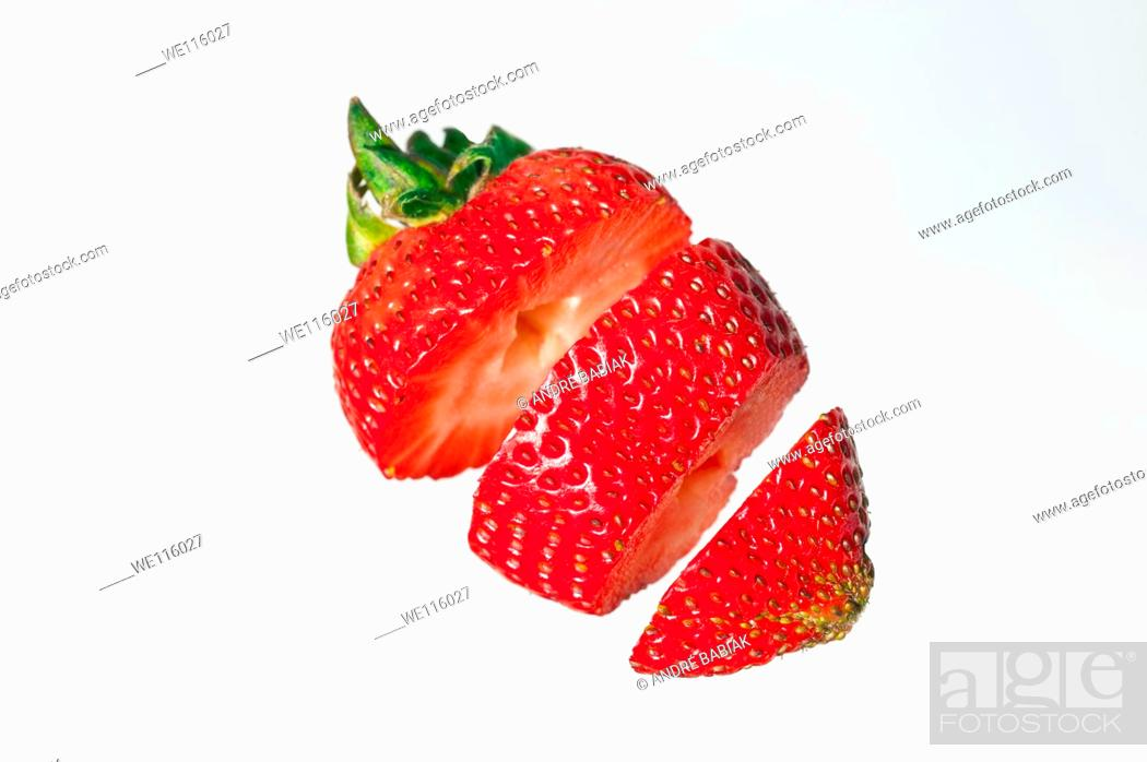 Stock Photo: Strawberry cut in pieces.