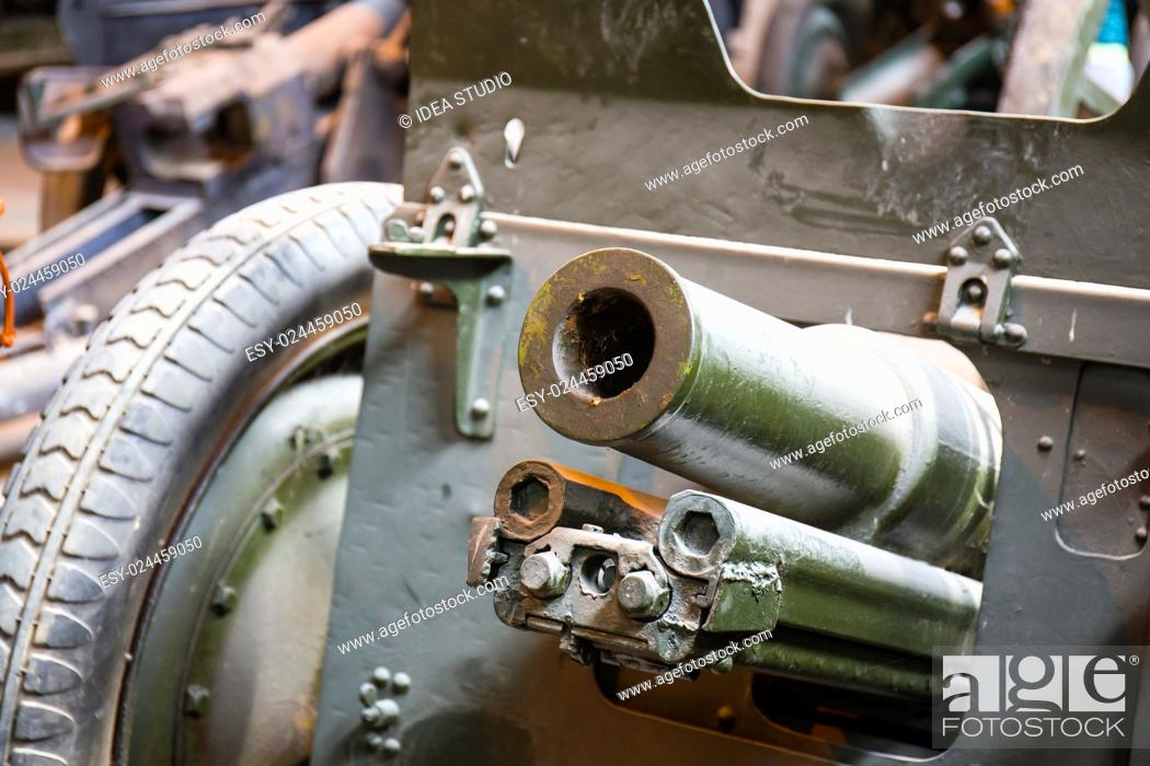 Stock Photo: Old soviet military howitzer close up view.
