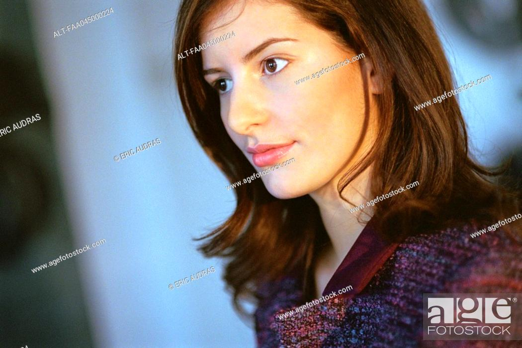 Stock Photo: Young businesswoman looking away in thought, portrait.