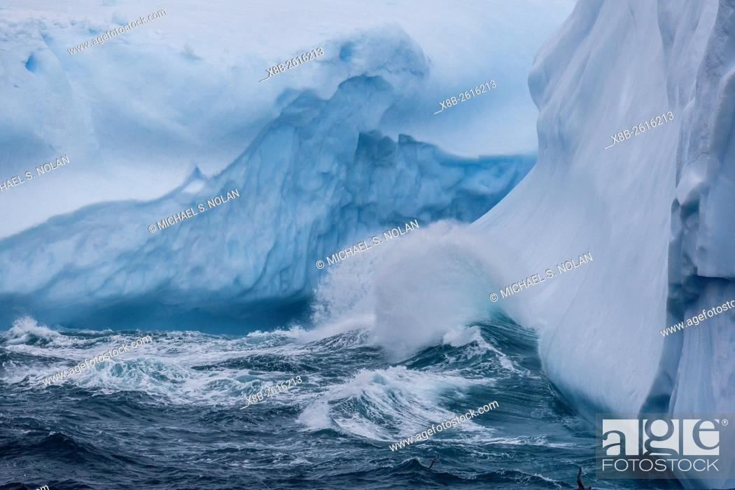 Stock Photo: Huge swell breaking on tabular iceberg broken off from B-17A Iceberg near Cooper Bay, South Georgia.