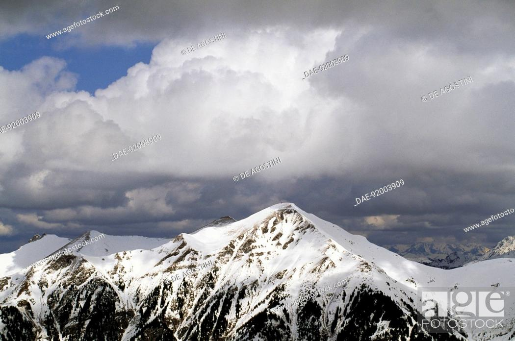 Stock Photo: Clouds on the snow-capped summit of Mount Gamskarkogel, Austria.