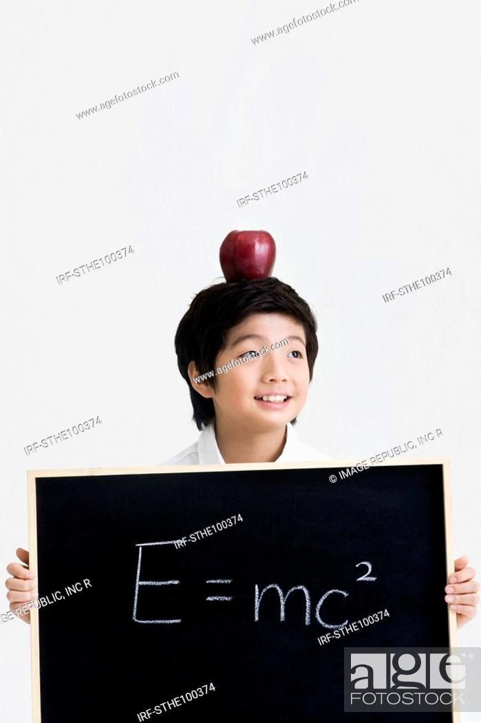 Stock Photo: boy holding a blackboard.
