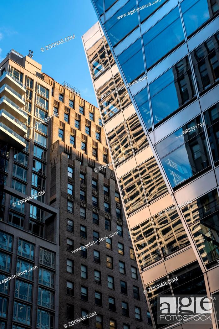 Stock Photo: New York City - USA - DEC 26 2018: Perspective view to facade fragment of a modern building around Bryant Park Manhattan.