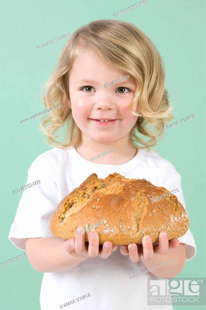 Stock Photo: Girl holding bread.