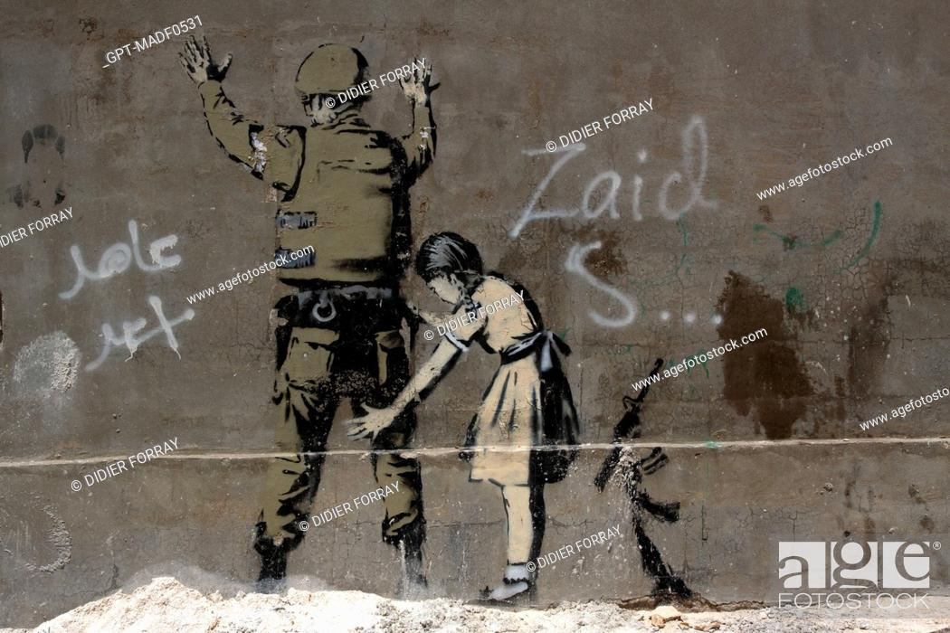 Stock Photo: YOUNG GIRL FRISKING A SOLDIER, DRAWING BY THE BRITISH GRAFFITI ARTIST BANKSY ON A WALL IN BETHLEHEM, WEST BANK, PALESTINIAN AUTHORITY.