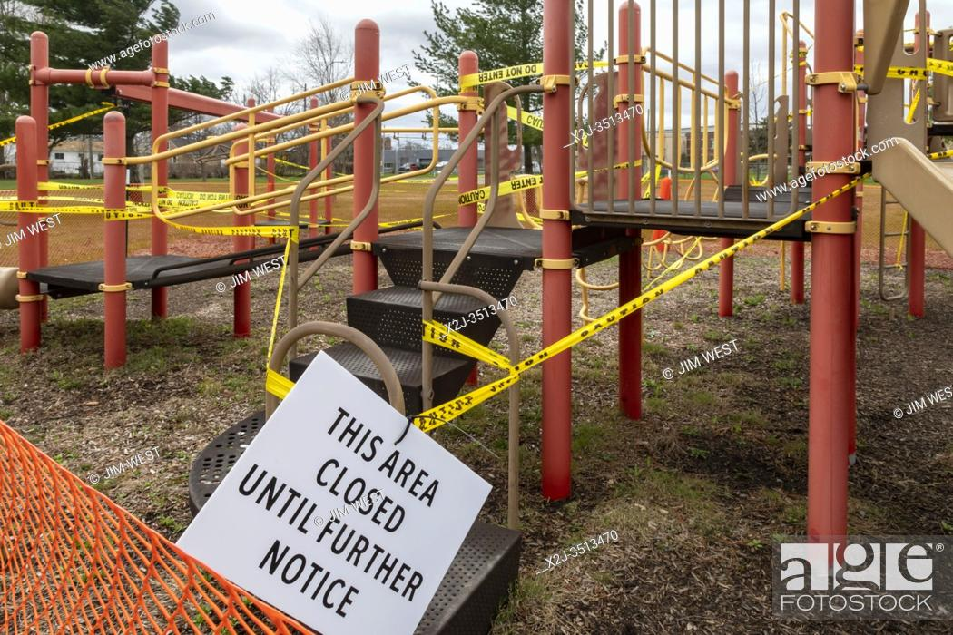 Stock Photo: Ferndale, Michigan USA - 13 April 2020 - A playground in Wanda Park is closed due to the coronavirus pandemic.