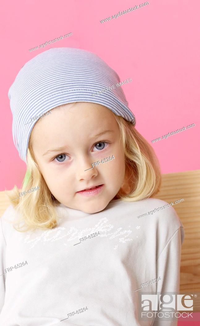 Stock Photo: Blond girl wearing a headscarf.