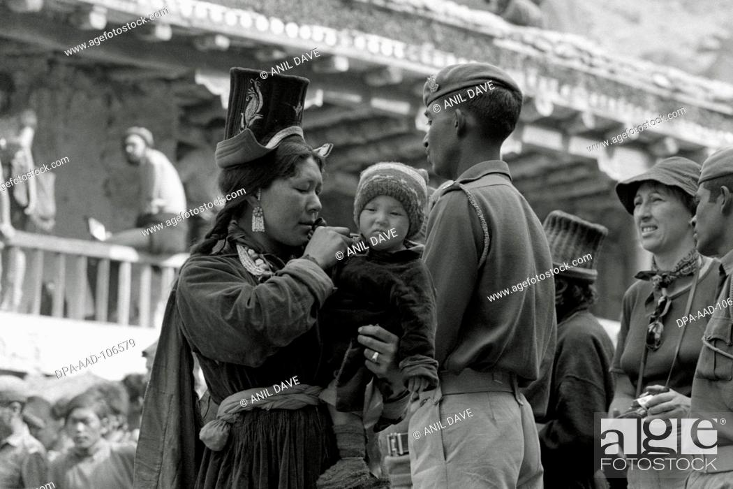 Stock Photo: Mother holding her child in hand on Hemis festival at Hemis Gompa ;  Ladakh ; Jammu and Kashmir ; India.