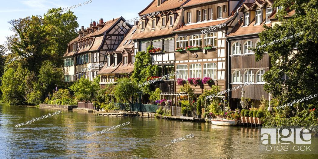 Imagen: Germany, Bavaria, Bamberg, River Regnitz and Little Venice townhouses in spring.