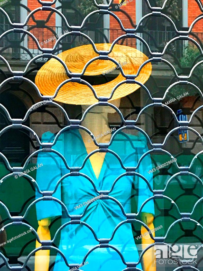 Stock Photo: Mannequin in the shop window of a closed shop. Madrid, Spain.