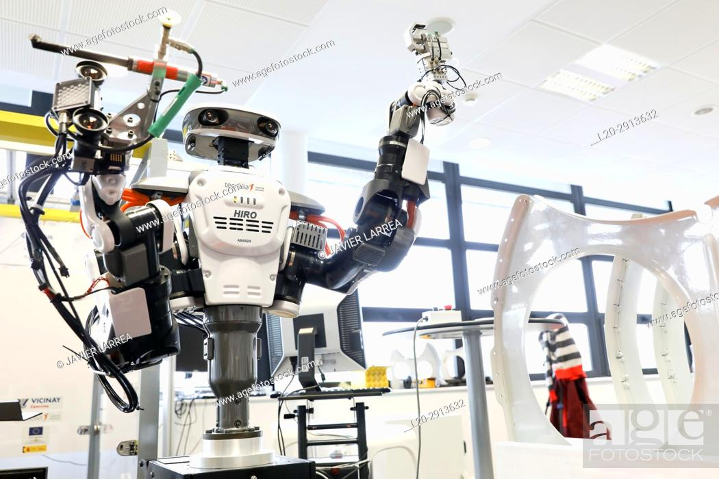 Stock Photo: Robot with two arms for flexible robotics. Humanoid robot for automotive assembly tasks in collaboration with people, Industry, Tecnalia Research & innovation.