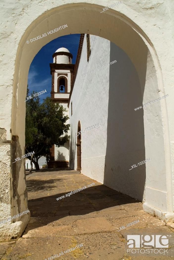 Stock Photo: ANTIGUA FUERTEVENTURA Iglesia de Nuestra Senora de Antigua church bell tower and arch.
