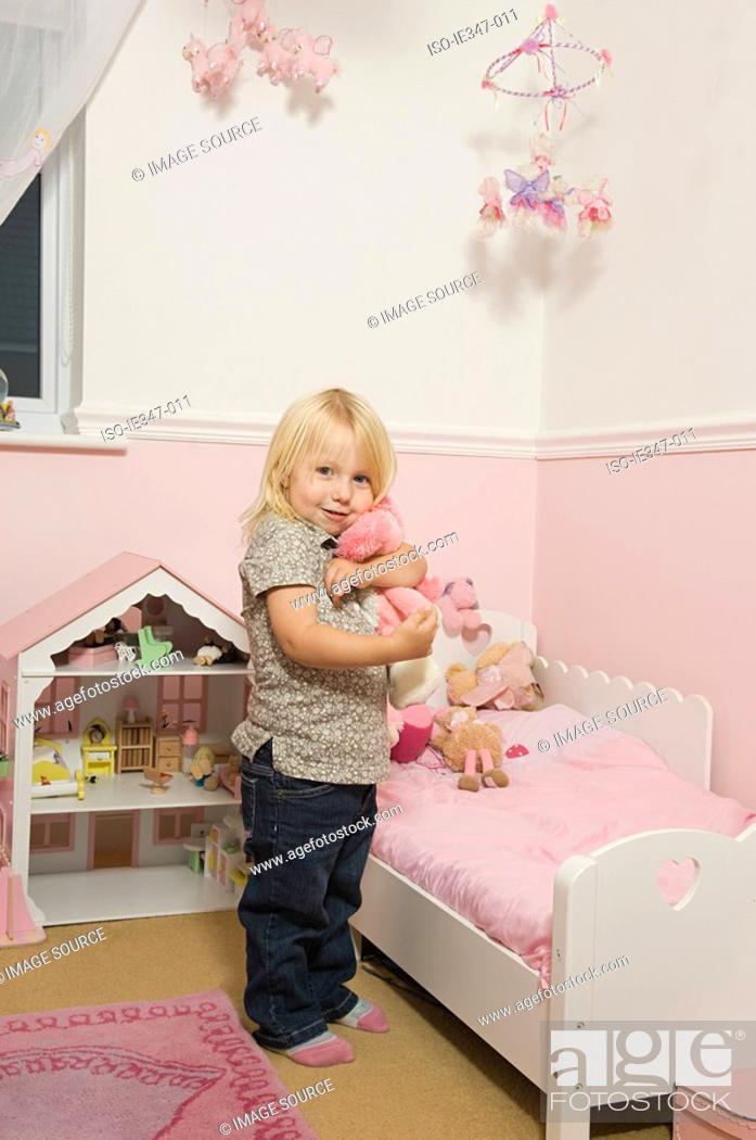 Stock Photo: Little girl in her room.