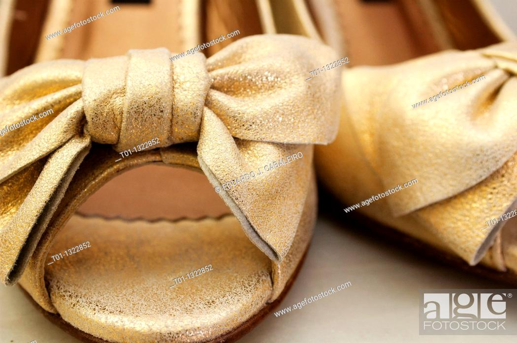 Stock Photo: Golden wedding shoes.