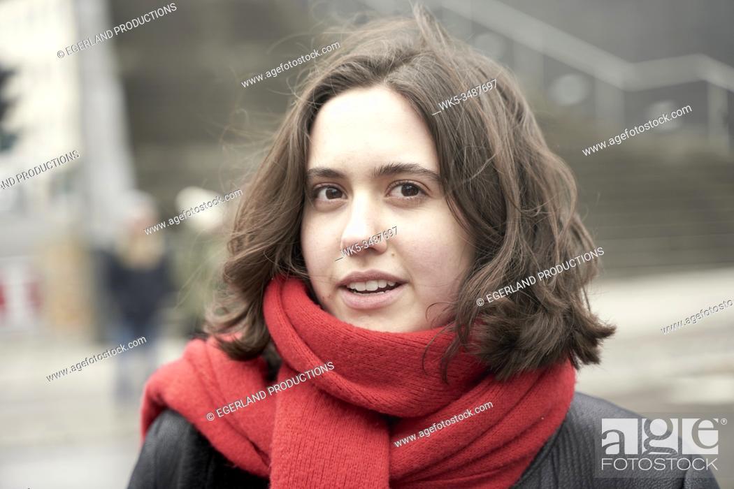 Stock Photo: woman wearing scarf.