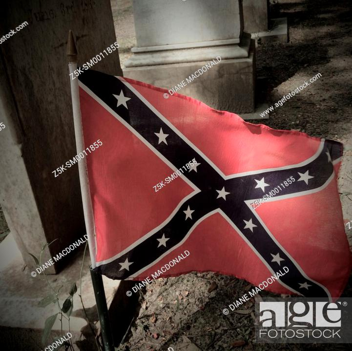 Stock Photo: Confederate flag on a grave in the graveyard of Christ Church, St. Simon's Island, Georgia.