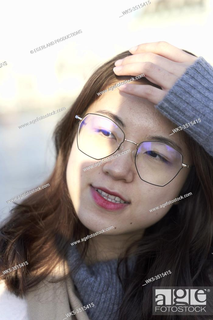 Stock Photo: portrait of young Asian woman.