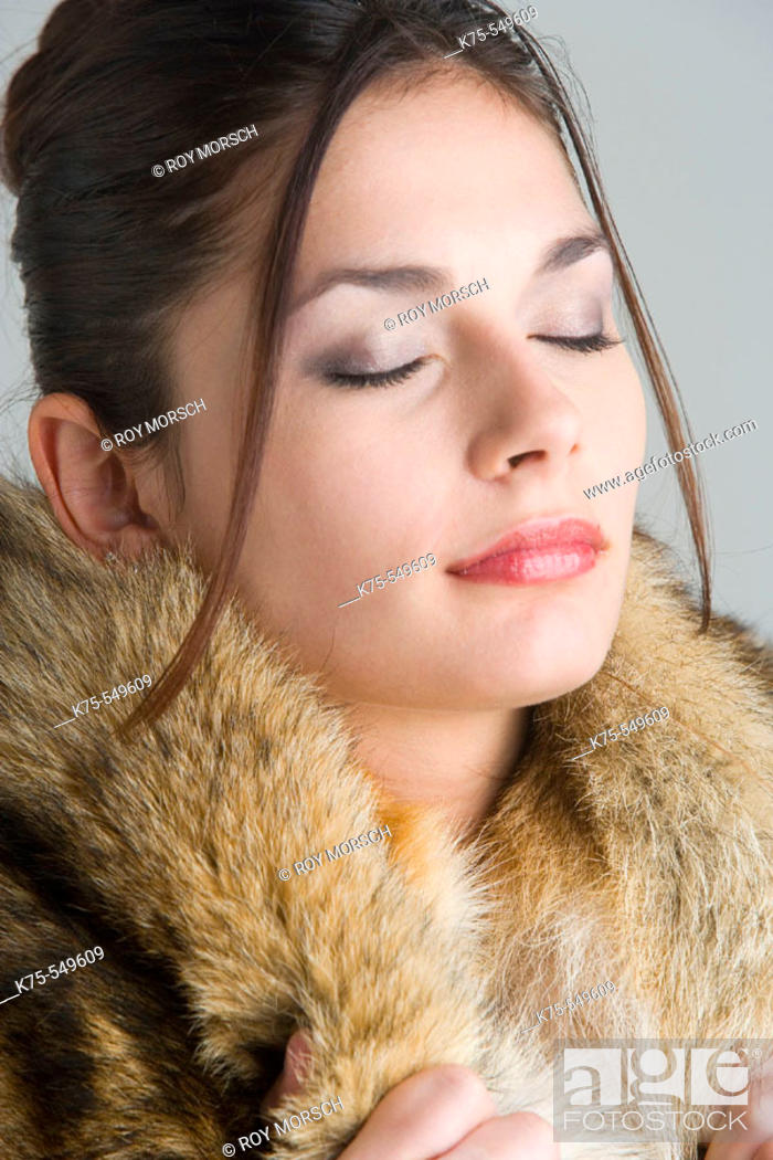 Stock Photo: woman with fur around her neck.