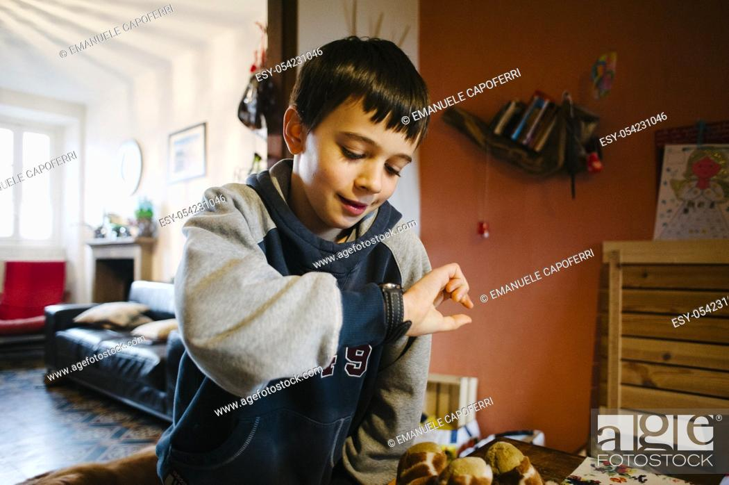 Stock Photo: Child looks in his wristwatch.