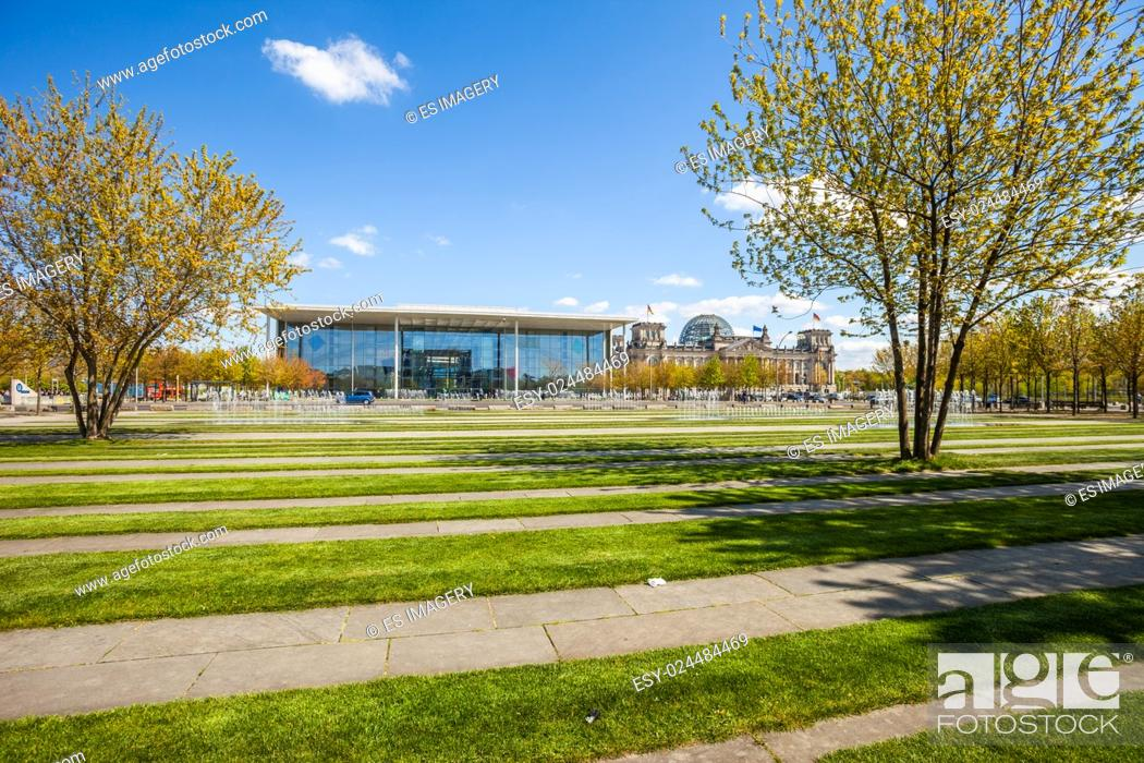 Stock Photo: The Paul Loebe Haus and Reichstag in Berlin, Germany with lawn and fountain.