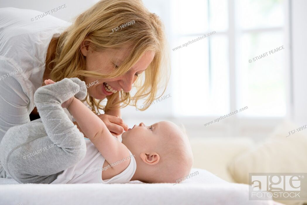 Stock Photo: Mother with her baby son.