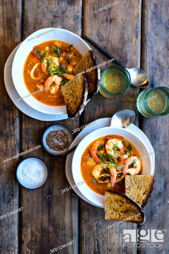 Stock Photo: Fish and seafood soup with chorizo, tomatoes and toasted bread.