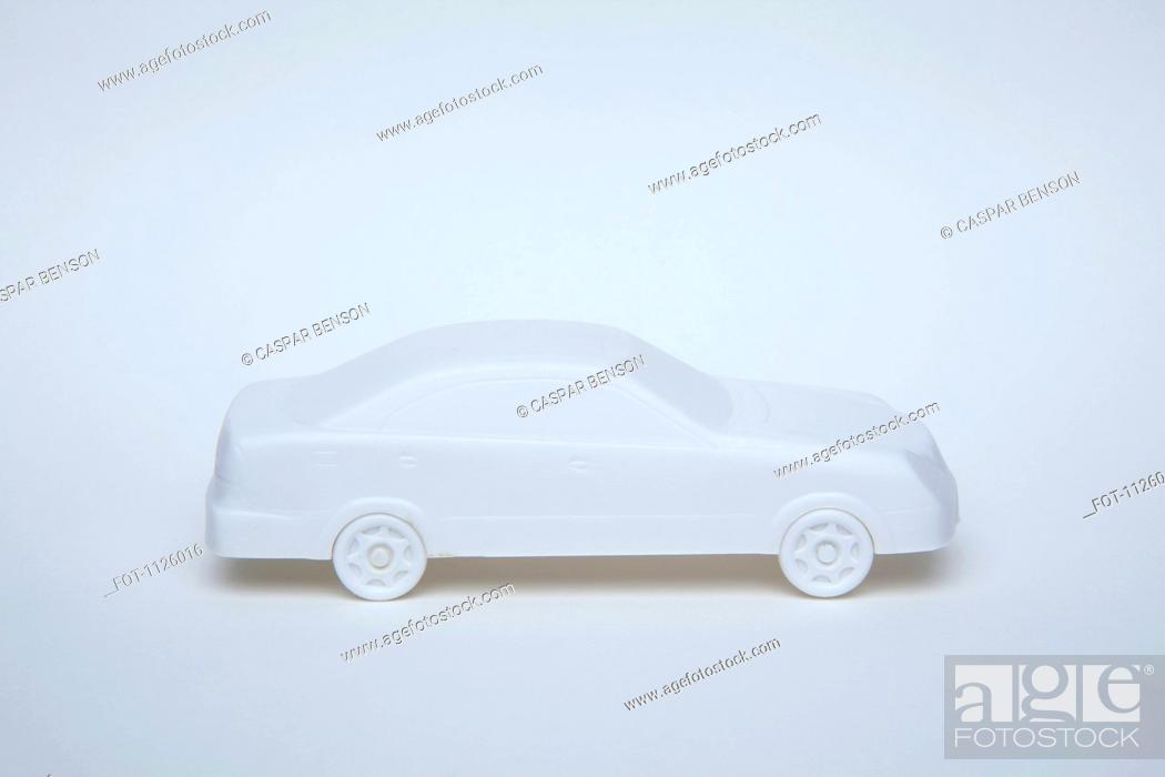 Stock Photo: A white miniature model car on a white background.