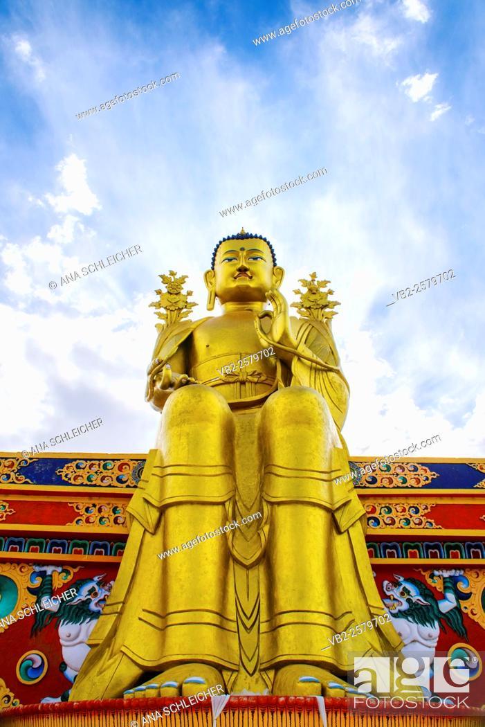 Stock Photo: Maitreya, the futur Buddha. Golden Buddha statue in Likkir (Ladakh, India) seatting in a color decorated bench.