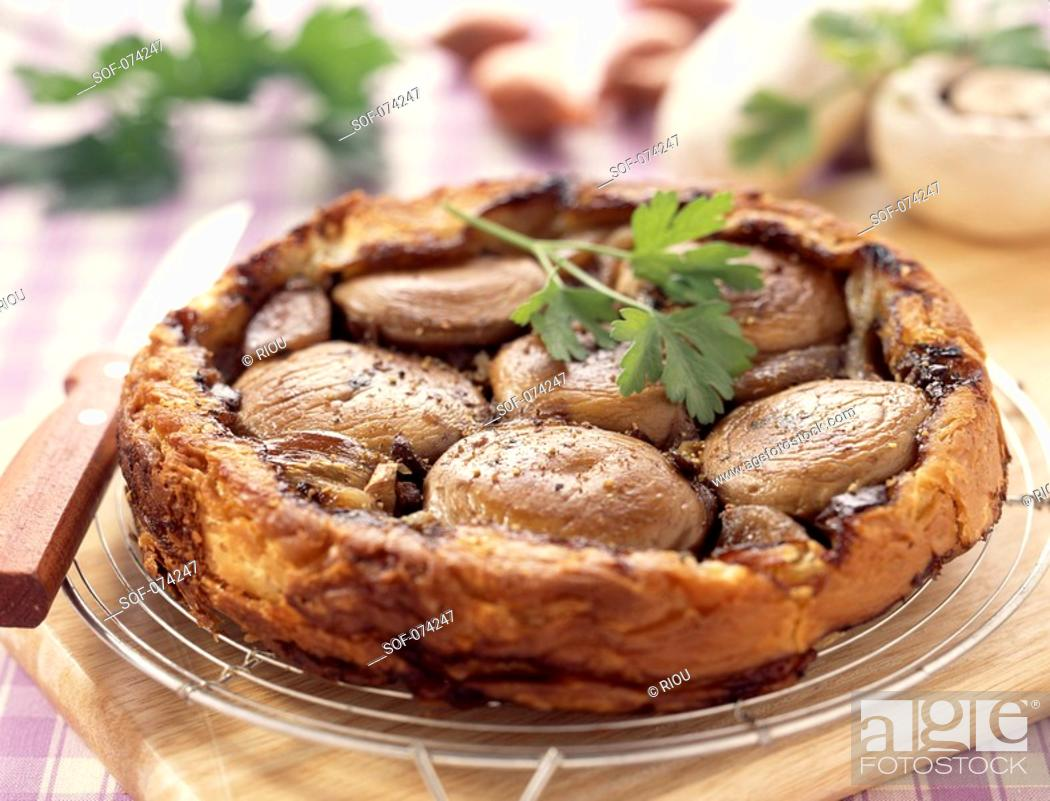 Stock Photo: Button mushroom and shallot tatin tart.