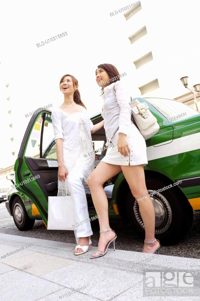 Stock Photo: Women who got off the taxi.