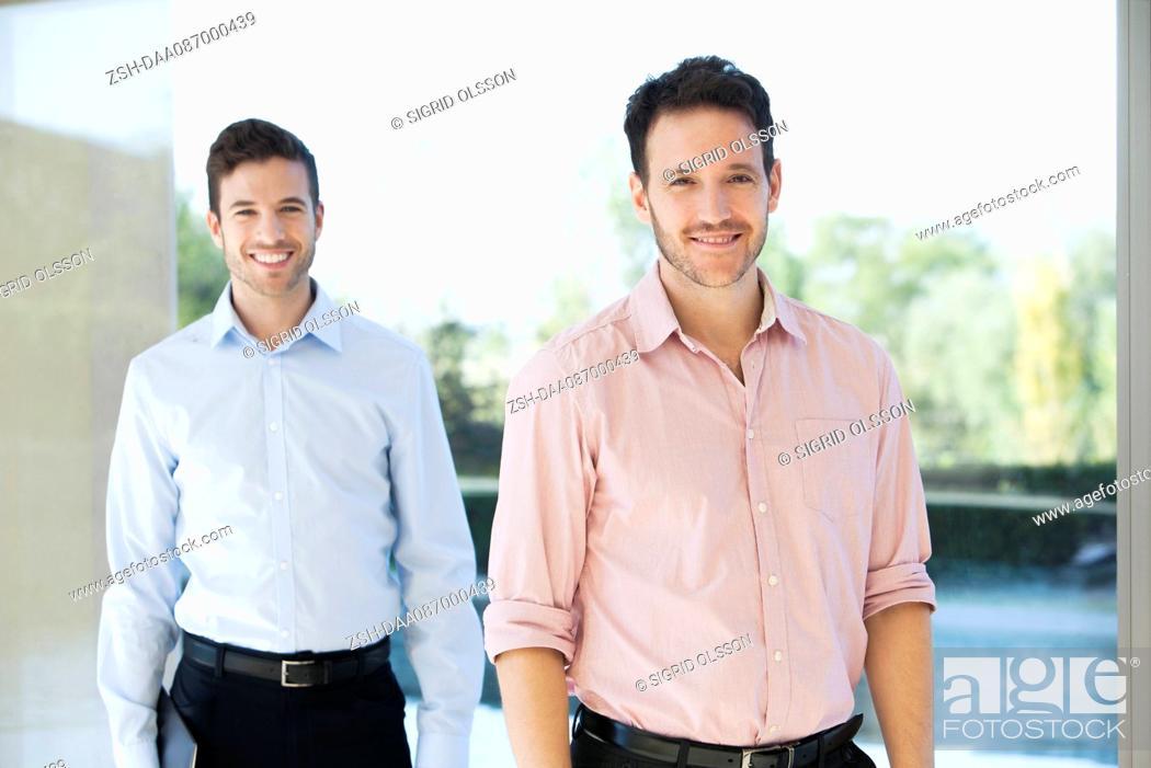 Stock Photo: Businessmen, portrait.