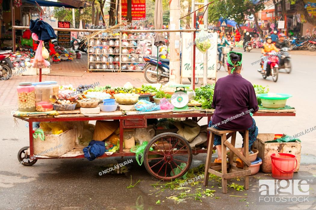 Stock Photo: Woman peddler in Hai Phong, Vietnam, Asia.