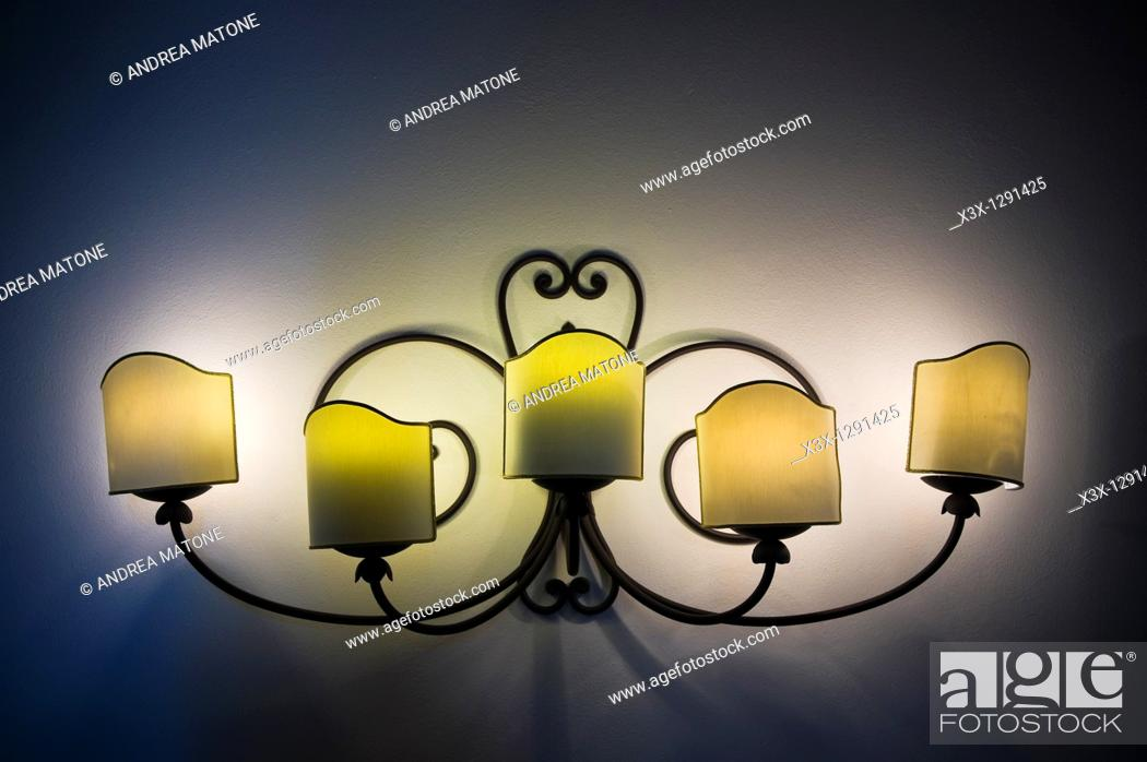 Stock Photo: Lit wall lamp in the dark.