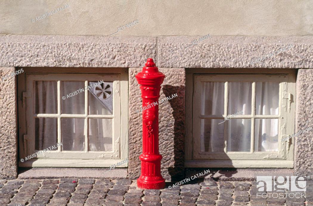 Stock Photo: Fyre hydrant and windows.